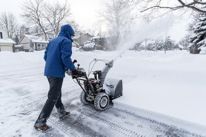 Man Clearing Snow with a Snow Blower